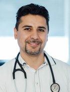 Dr. Kambiz Modarressy